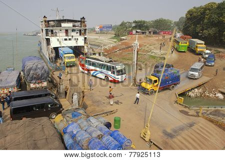 Ferry boat unloads at Ganga river bank, Bangladesh.