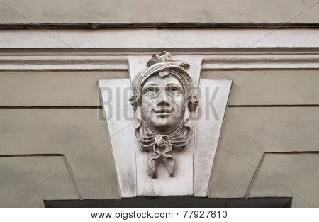Old Bas-relief Smiling Female Head