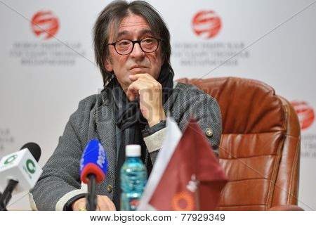 NOVOSIBIRSK, RUSSIA - DECEMBER 5, 2014: Russian conductor and violist Yuri Bashmet talks with press on the opening of the festival Classics. The festival joins the concerts of the World music stars