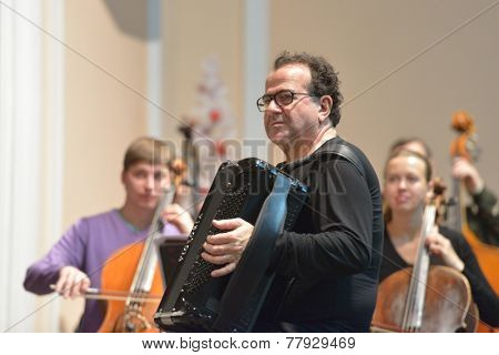 NOVOSIBIRSK, RUSSIA - DECEMBER 8, 2014: French accordionist Richard Galliano on the rehearsal with chamber orchestra during the festival Classics. The event joins the concert of the World music stars