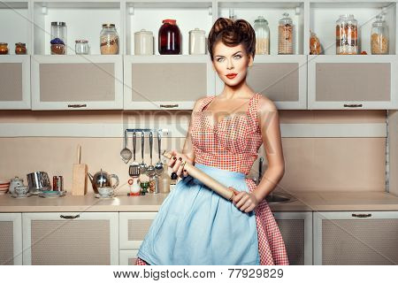 Woman Holding A Rolling Pin.