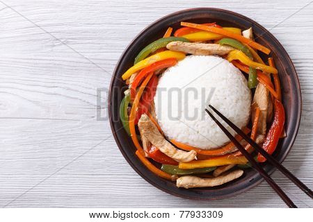 Rice With Chicken, Vegetables And Chopsticks  Top View