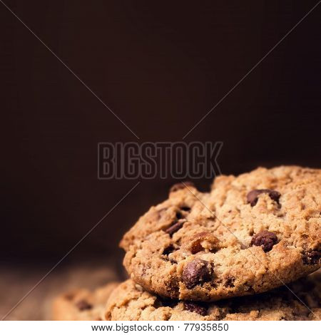 Chocolate Chip Cookies On Wooden Background. Stacked Chocolate Chip Cookies Shot With Selective Focu