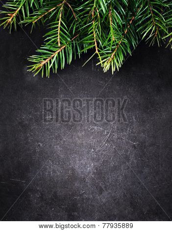 Christmas Background With  Fir Tree On Vintage Black Board With Free Blank Copy Space For Greeting T