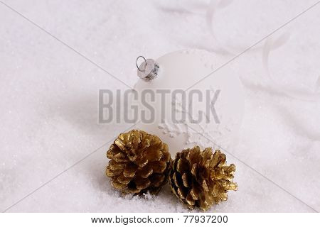 Christmas Ball, Two Gold Pine Cones In Snow