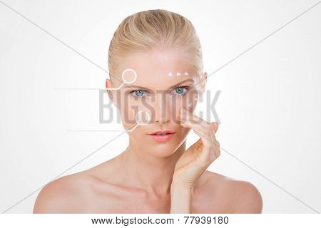 Blond Woman With Points On Her Face Checks The Effects Of Her Salve