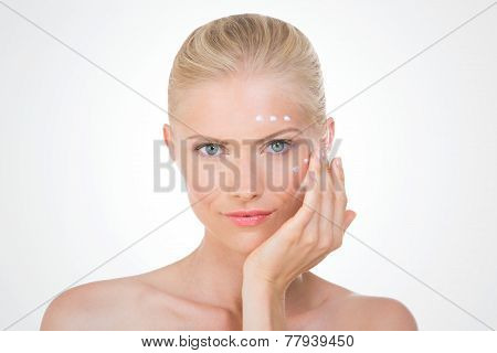 Nordic Girl Applying Salve On Her Face