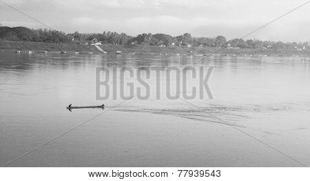 A Man On A Boat In Mekong River In Loei Province