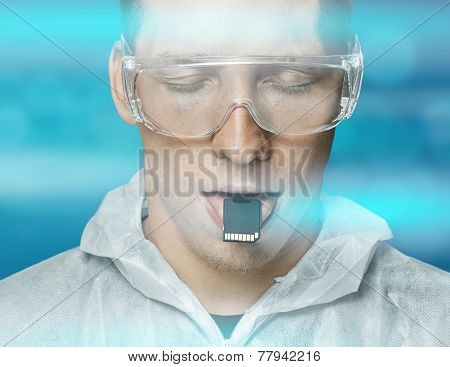 Young Man Holding Memory Card On His Tongue