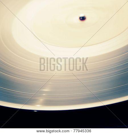 Spinning vinyl record. Shallow depth of field.