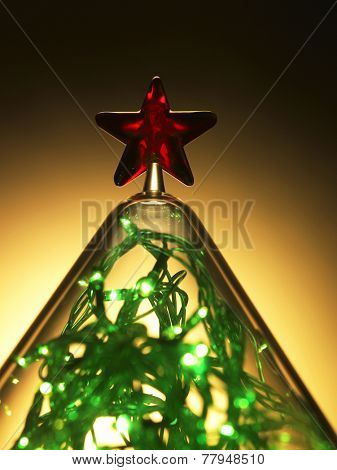sparking light covered with the cone shape container with star on top