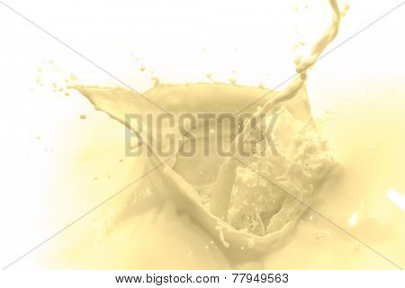 pouring vanilla flavored milk on white background