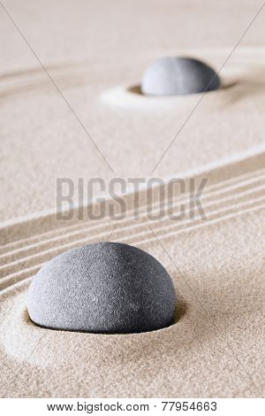 harmony zen background Japanese sand garden with round stones or rocks.