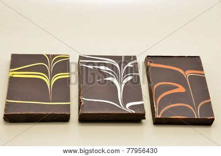delicious chocolate bar on a uniform background