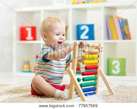 kid boy playing with abacus