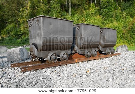Three mine carts