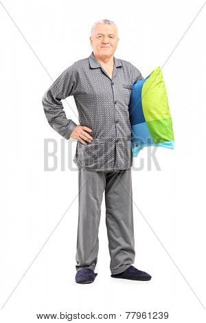 Full length portrait of a senior in nightwear holding a pillow isolated on white background