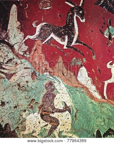 chinese frescoe of a deer on a red background, cave Dunhuang, Gansu Province, China