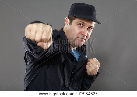 Security Guard Attack Position Isolated On Gray Background