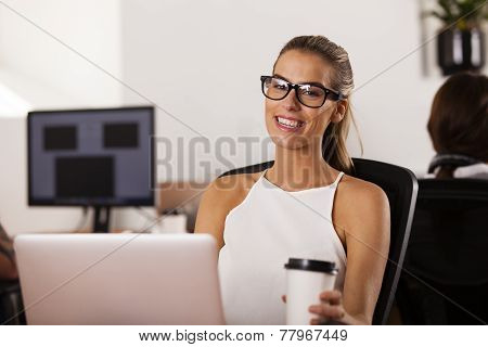 Young Entrepreneur Smiling In Her Startup Office
