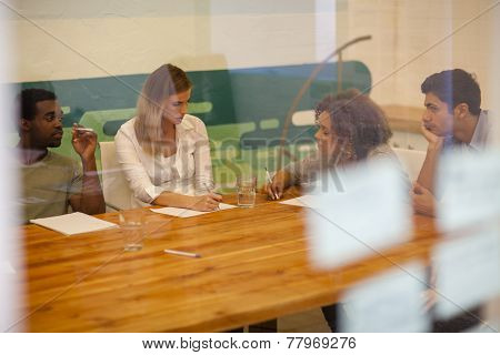 Startup Team Discussing In Their Office Boardroom
