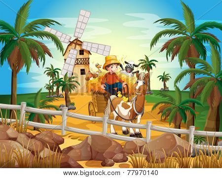 A young farmer at the farm with his animals