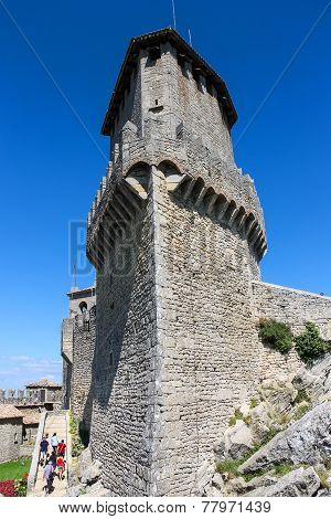 Tourists See The Sights In Courtyard Of Fortresses Guaita On Mount Titan. The Republic Of San Marino