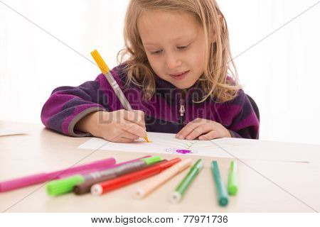 Child rapt with drawing