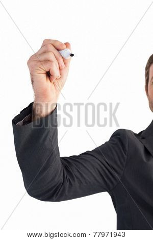 Businessman writing with a marker on white background