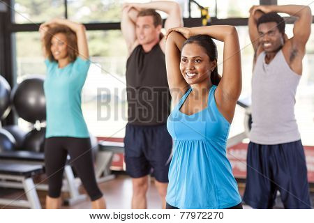 Multi-ethnic Group Stretching In A Gym