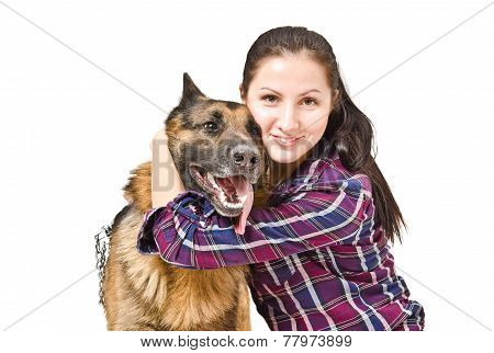 Portrait of a beautiful young woman embracing a German shepherd
