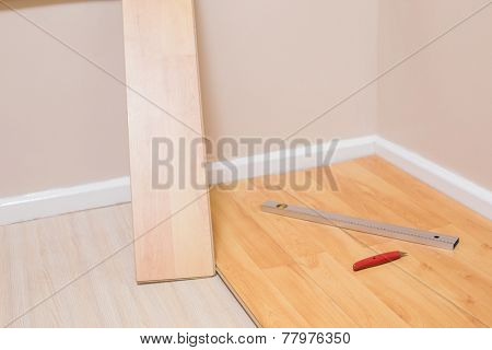 Planks being put down on floor in a new house