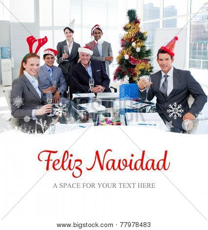 Portrait of a smiling business team wearing novelty Christmas hat against feliz navidad