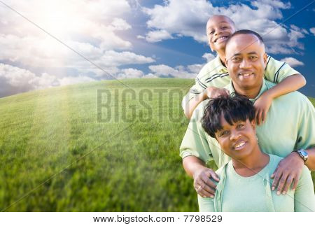 Family Over Clouds, Sky And Grass Field