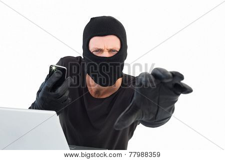 Hacker reaching out to camera on white background