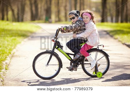 girl and boy riding on bicycle