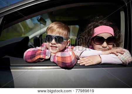 girl and boy driving fathers car