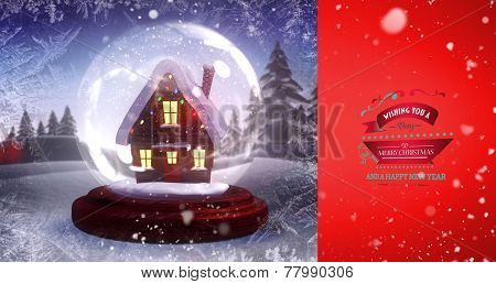 Snow falling against christmas house in a snow globe