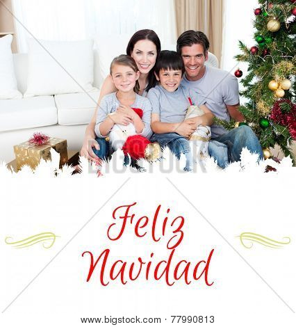Happy family at Christmas time holding lots of presents against border