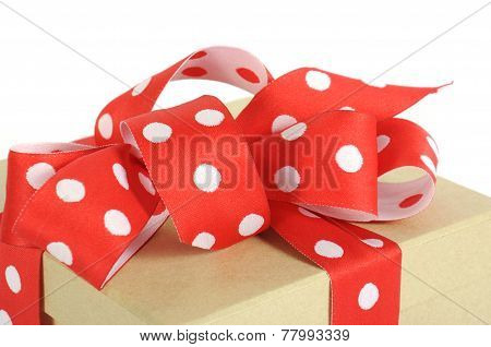 Natural Modern Trend Gift Wrapping With Brown Kraft Gift Box And Red And White Polka Dot Ribbon On W