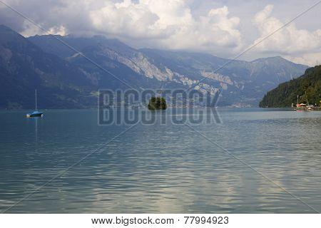 Alpine lake Brienz of Jungfrau region, viewed from Iseltwald in Switzerland