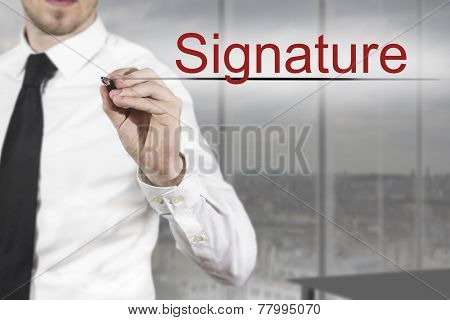 Businessman Writing Signature In The Air