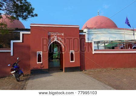 Unidentified man stands at the entrance to Ulugh Khan Jahan's mausoleum, Bagerhat, Bangladesh.