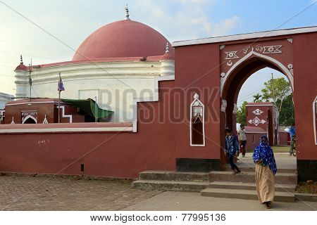 Unidentified people exit Ulugh Khan Jahan's mausoleum, Bagerhat, Bangladesh.