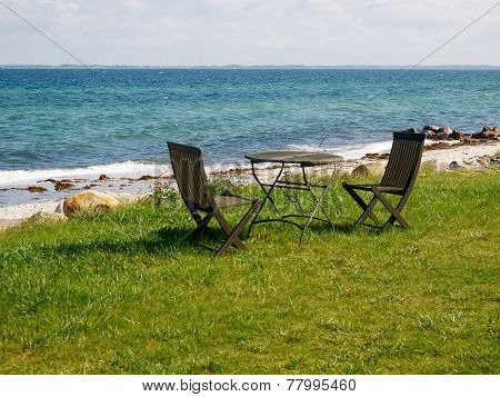 Chairs And Table On A Beautiful Beach