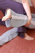 picture of thai massage  - Young Japanese Woman Getting a Thai Massage - JPG