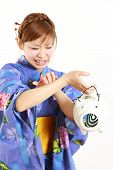 pic of mosquito  - Young woman wearing Japanese kimono with mosquito coil  - JPG