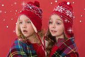 picture of blanket snow  - Festive little girls under a blanket against snow - JPG