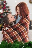 picture of blanket snow  - Festive mother and daughter wrapped in blanket against green fir branches with snow - JPG