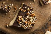 stock photo of toffee  - Homemade Chocolate English Toffee Topped with Nuts - JPG